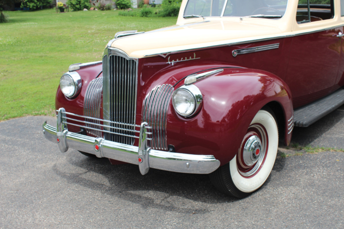 The elaborate grille work, fender spears and wide whitewalls are all key parts of the Packard's signature period look.
