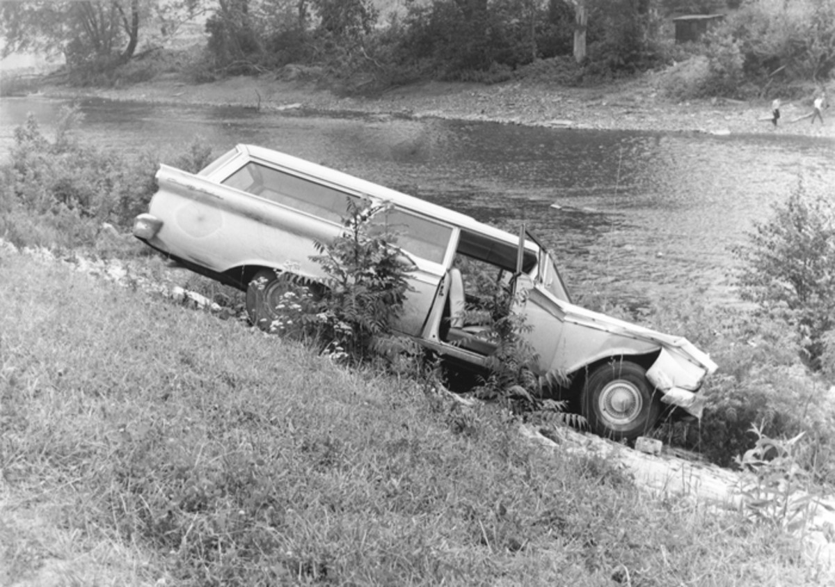 This Ford station wagon took a sudden ride over an embankment. A 3-year-old child climbed into the family car, tampered with the gearshift. The wagon drifted forward and plunged over the bank and into the stream. The startled child was not injured.