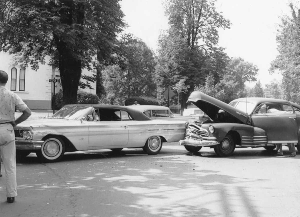 A 1948 Chevrolet Fleetline two-door stopped for the stop sign than entered the intersection, forming an unpleasant union with 1960 Pontiac Bonneville convertible.