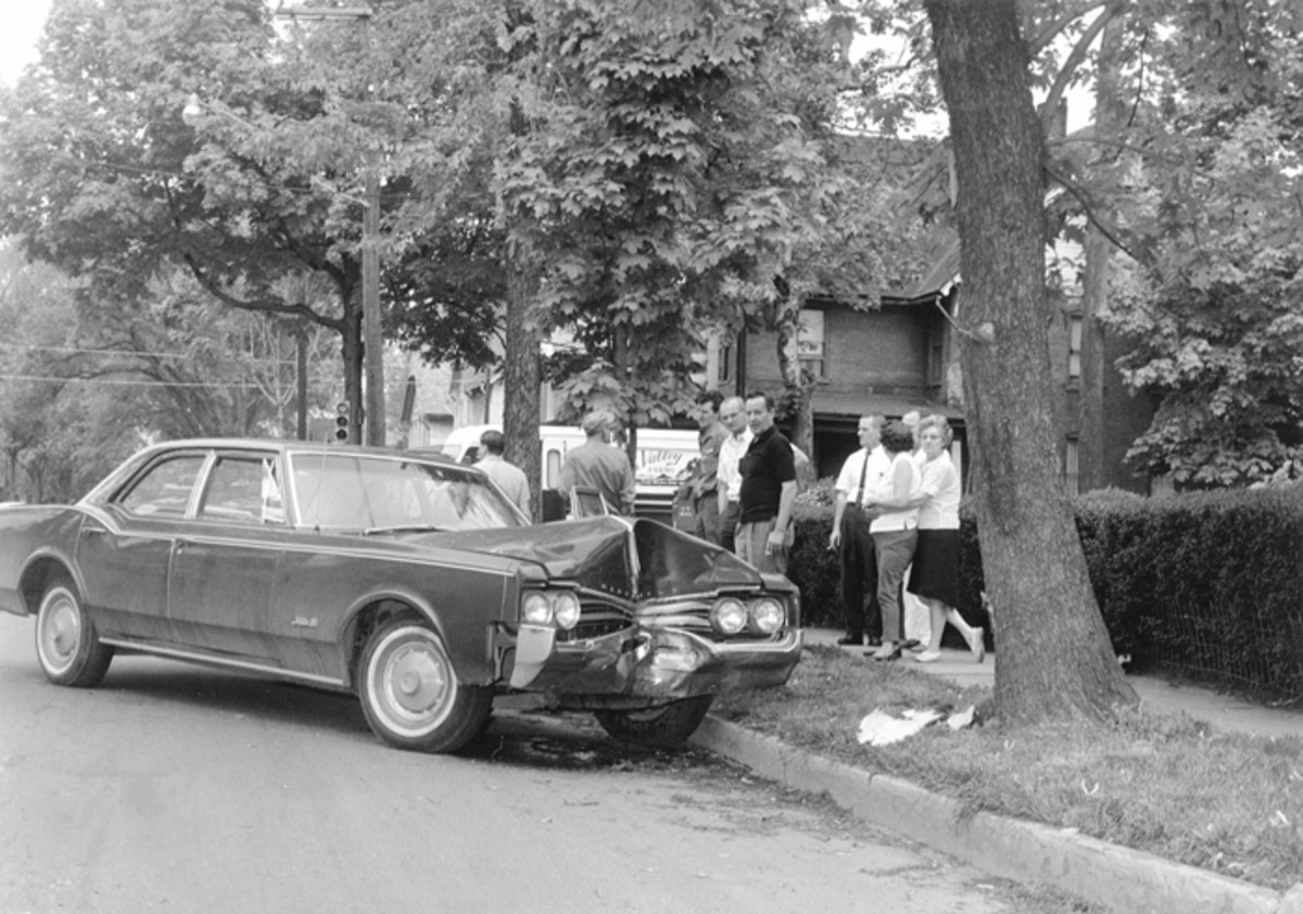 This 1966 Oldsmobile Delta 88 four-door sedan came to a hard stop at a spreading maple tree.