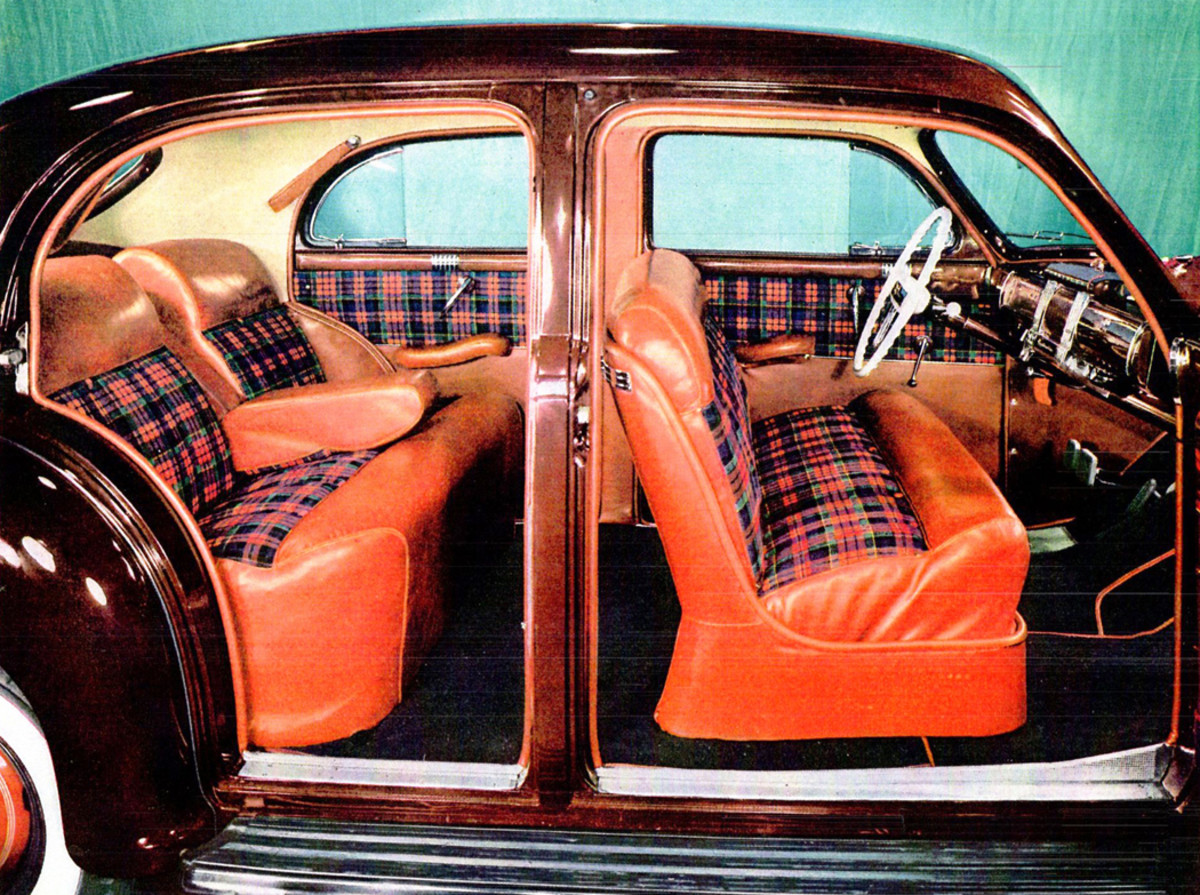 A new model for 1941, the Town Sedan, was introduced in the dealer showroom book with red and blue plaid fabric trimmed with red leather.