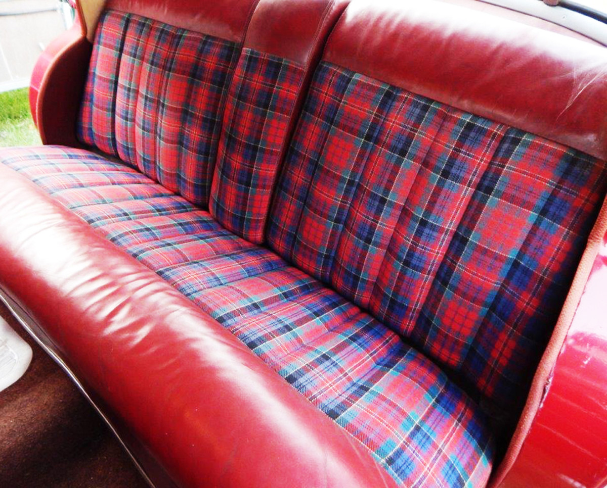 Restored interior in a 1946-48 convertible has blue and red plaid with red leather trim.