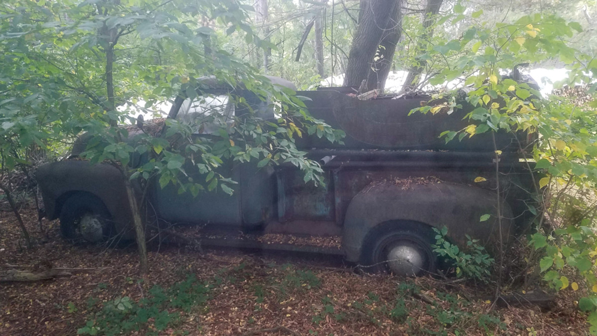 Josh Mihna, who found the truck, replaced the glass, headlamps, tailgate and other bits to make it complete after pulling it out of the woods where it had been hiding for decades