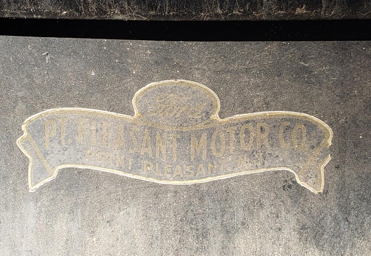 The original dealer sticker still resides on the rear of the car