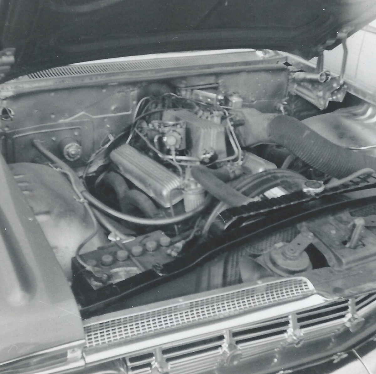 The engine compartment of Rosenbloom's 1959 Biscayne. Note the air intake tube to the fuel injection unit required on passenger car 1959 Chevrolets so equipped.