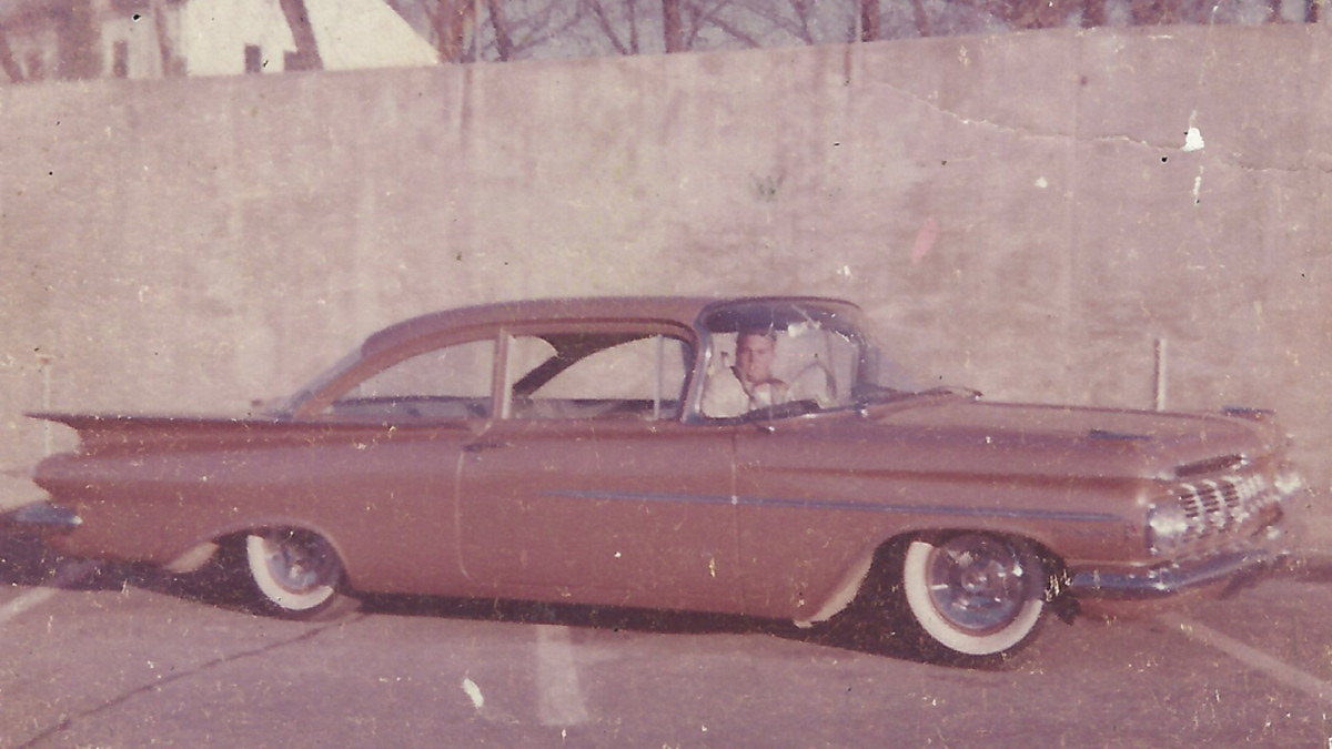 """Shelly Rosenbloom is behind the wheel in this pocket-size photo taken before 1962 of his fuel-injected 1959 Biscayne. The """"fuel injection"""" scripts and triangular emblems on the front fenders are barely visible."""