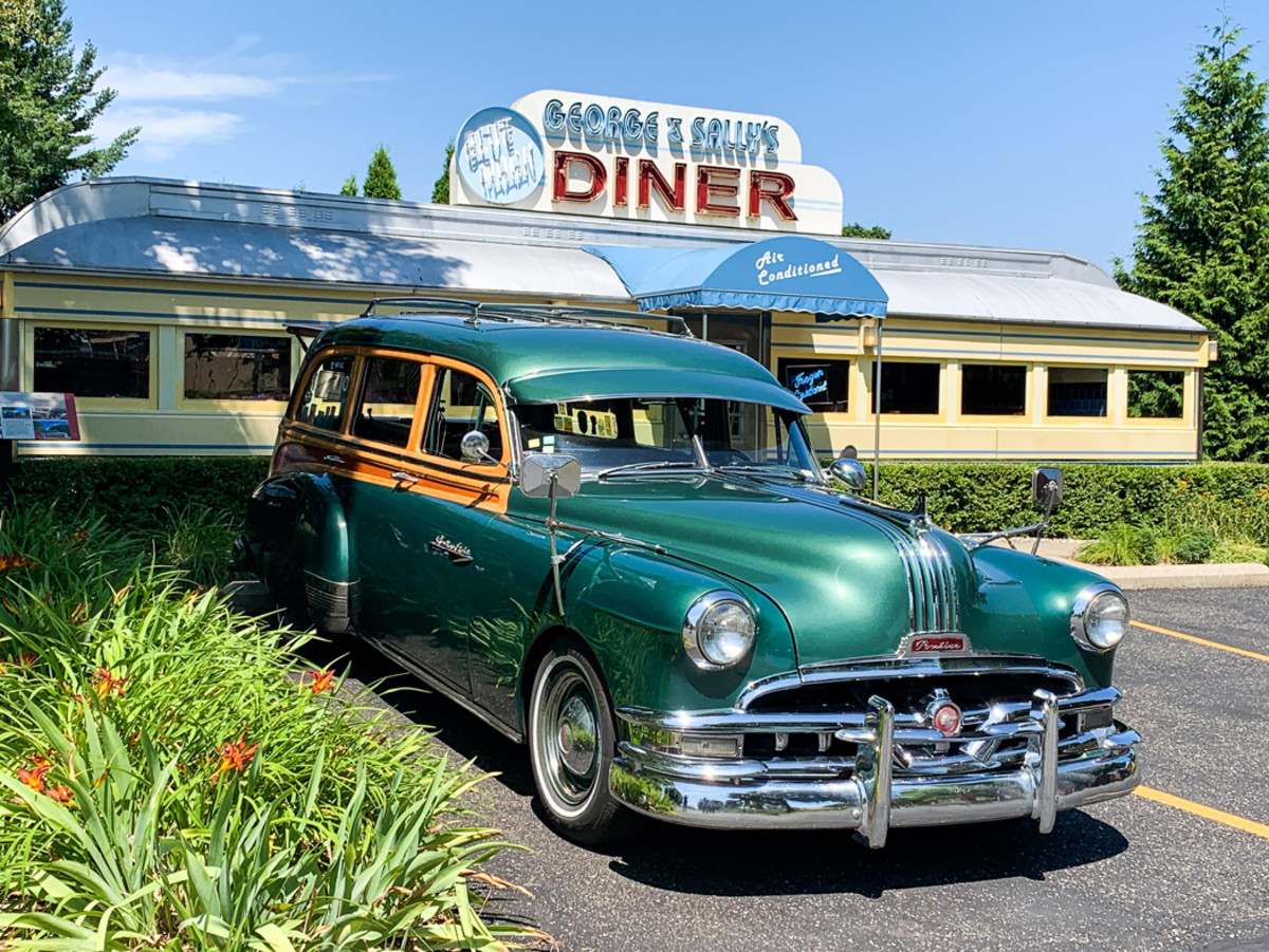 pontiac station wagon in front of diner-min