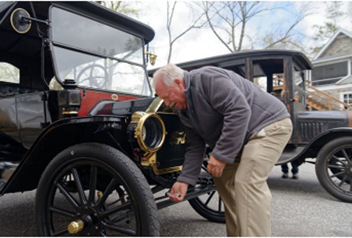 Student Brian Schell learning how to crank start the 1914 Ford Model T.