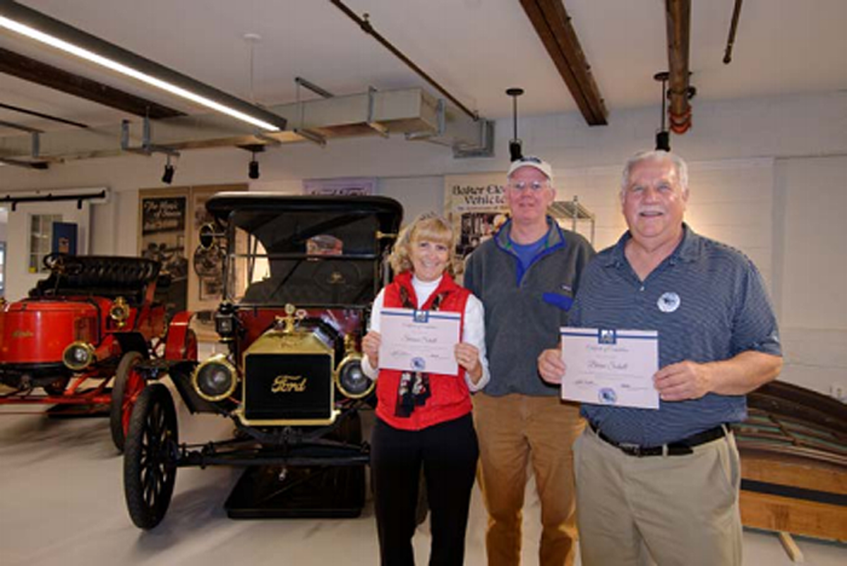 They passed! Students Sharon and Brian Schell with Marshall Steam Museum instructor John Trout, showing off their certificate of completion.