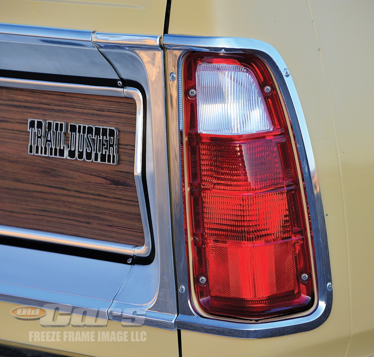 The Plymouth Trail Duster Sport features woodgrain trim on its tailgate and body-side moldings.