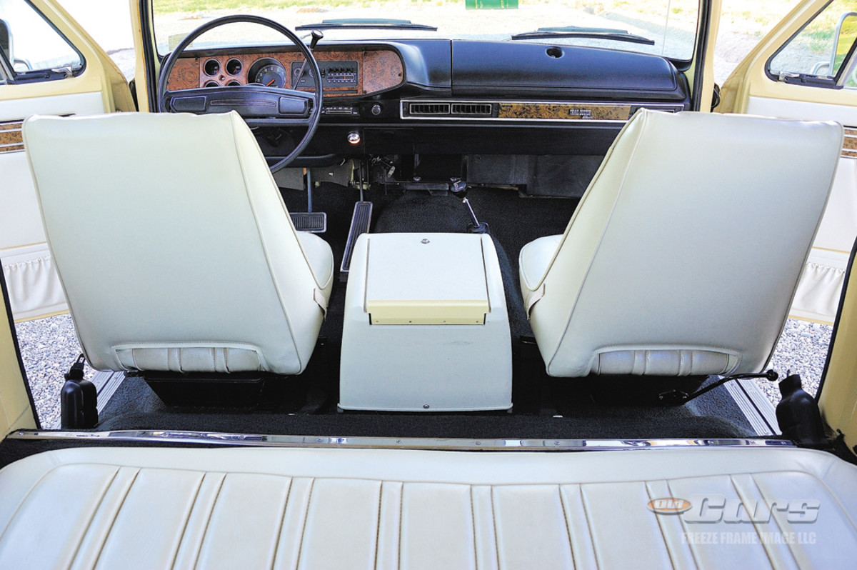Deluxe tilting vinyl bucket seats,color-keyed door trim panels and a lockable console were standard Trail Duster Sport features.