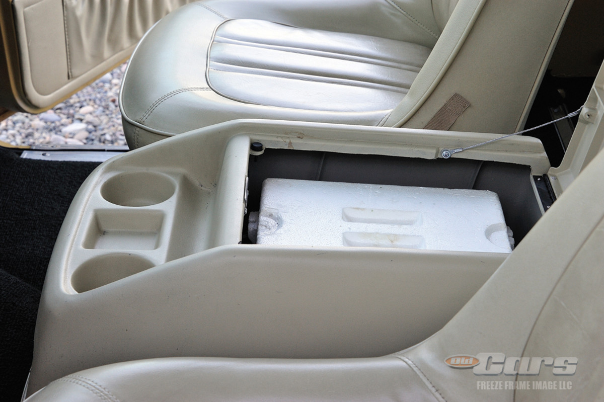 The center console houses built-in cup holders and serves as a storage container for a factory-provided Styrofoam cooler.
