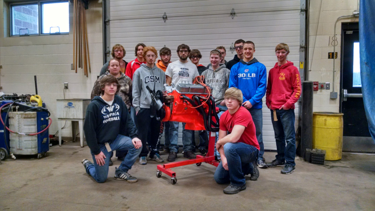 Here's 14 of the students with the Chevy 350-cid V-8 they later installed in the car.