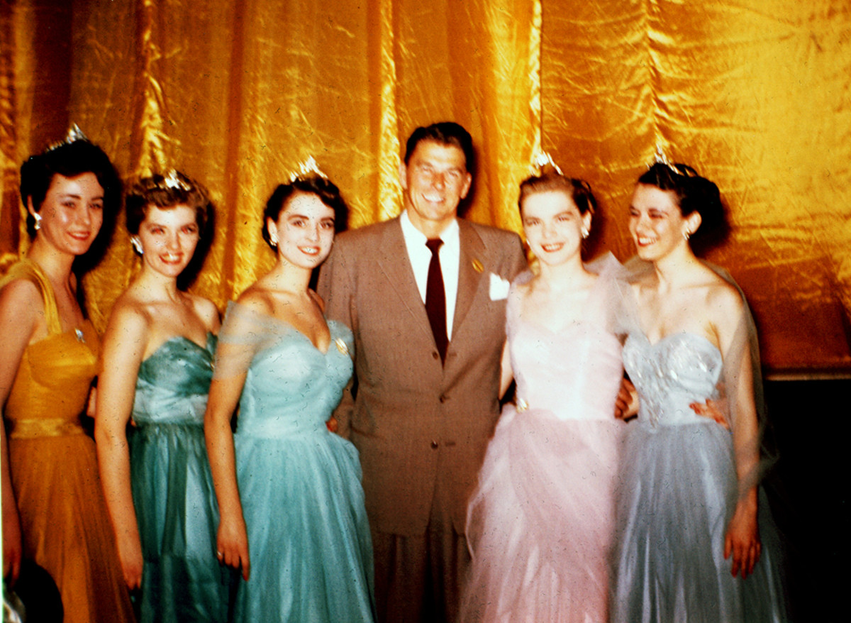 Lucky Ronald W. Reagan was surrounded by a group of Chicago Auto Show beauty queens. The 43-year-old actor served as grand marshal for the 1954 Chicago Auto Show, and was the host for TV's General Electric Theater. June is the second from the right.