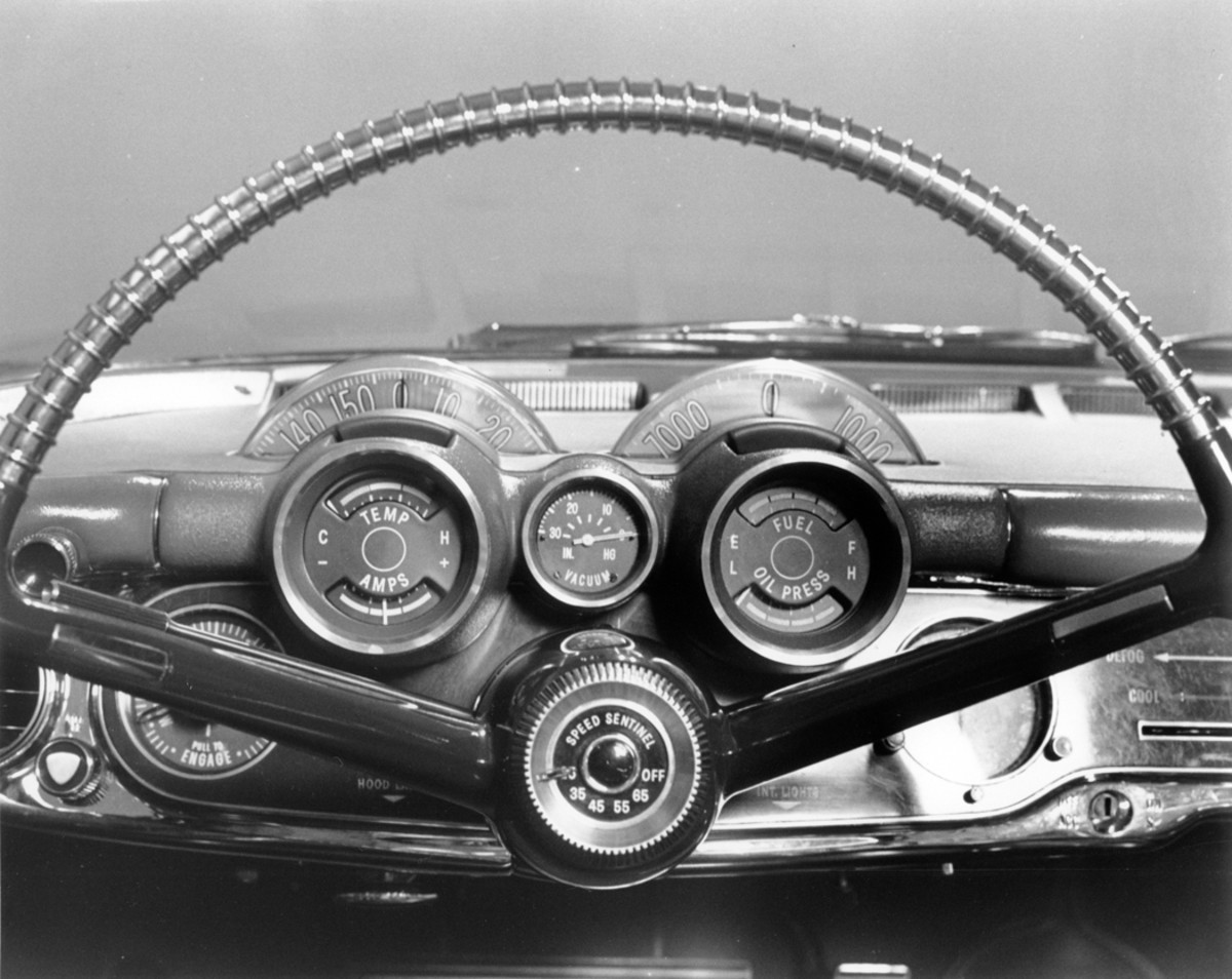 """A full set of gauges occupied the driver's side of the instrument panel. At top were rotating dials for the speedometer and the engine revolutions. In the center of the steering wheel hub was the """"speed sentinel"""" which alerted the driver via a buzzing sound that a preset speed had been exceeded."""