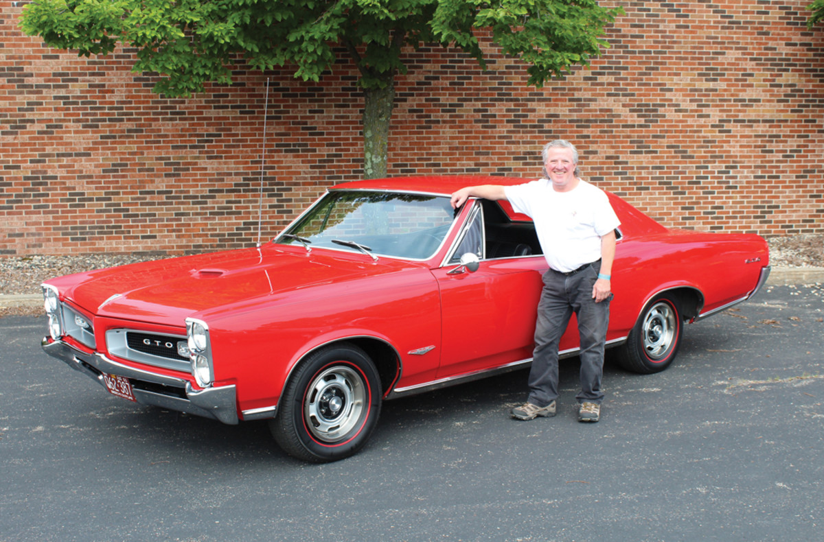 Dan Staehle next to his '66 GOAT